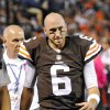 Photo - In this photo taken on Thursday, Oct. 3, 2013, Cleveland Browns quarterback Brian Hoyer limps off the field early in an NFL football game against the Buffalo Bills in Cleveland. Hoyer, the hometown quarterback who sparked the Browns to two straight wins, will miss the rest of the season with a torn right knee ligament. (AP Photo/David Richard)