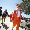 Photo - Oklahoma State Fan Philip Parr walk to the stadium before the Cowboys played Texas A&M in College Station, Texas on Saturday. Photo by Sarah Phipps, The Oklahoman