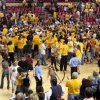 Arizona State fans celebrate on the court following the Sun Devils 68-58 victory over Southern California Sunday, Feb. 18, 2007, in Tempe, Ariz. This was Arizona State\'s first win in PAC-10 play.(AP Photo/Roy Dabner)