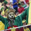 A Cameroon fan cheers before the group A World Cup soccer match between Cameroon and Croatia at the Arena da Amazonia in Manaus, Brazil, Wednesday, June 18, 2014. (AP Photo/Marcio Jose Sanchez)
