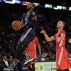 East Team\'s Kyrie Irving, of the Cleveland Cavaliers (2) goes to the hoop against the West Team during the NBA All Star basketball game, Sunday, Feb. 16, 2014, in New Orleans. (AP Photo/Gerald Herbert)
