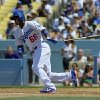 Photo - Los Angeles Dodgers' Yasiel Puig hits a single during the fifth inning of a baseball game against the Colorado Rockies, Sunday, July 14, 2013, in Los Angeles. (AP Photo/Mark J. Terrill)