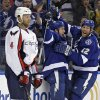 Photo - Tampa Bay Lightning right wing B.J. Crombeen, center, celebrates with teammate Ryan Malone, right, after scoring past the Washington Capitals, including defenseman John Erskine, left, during the second period of an NHL hockey game Thursday, Jan. 9, 2014, in Tampa, Fla. (AP Photo/Chris O'Meara)