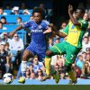 Photo - Chelsea's Willian, left is challenged by Norwich's Alexander Tettey during their English Premier League soccer match between Chelsea and Norwich City at Stamford Bridge stadium in London Sunday, May 4, 2014. (AP Photo/Alastair Grant)