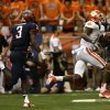 Photo - Clemson wide receiver Martavis Bryant (1) runs for a touchdown past Syracuse safety Durell Eskridge (3) during the first half of an NCAA college football game on Saturday, Oct. 5, 2013, in Syracuse, N.Y. (AP Photo/Mike Groll)