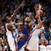 Oklahoma City\'s Kendrick Perkins (5) and Thabo Sefolosha (2) defend New York\'s Tyson Chandler (6) during the NBA game between the Oklahoma City Thunder and the New York Knicks at Chesapeake Energy Arena in Oklahoma CIty, Saturday, Jan. 14, 2012. Photo by Bryan Terry, The Oklahoman