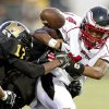 Del City\'s Quinn Ashford loses control of the ball as he is hit by Cortrez Colbert of Midwest City during a high school football game in Midwest City, Okla., Friday, September 3, 2010. Photo by Bryan Terry, The Oklahoman ORG XMIT: KOD