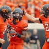 Oklahoma State\'s J.W. Walsh (4), Josh Stewart (5) and Oklahoma State\'s Caleb Muncrief (2) celebrate a Stewart touchdown during a college football game between Oklahoma State University (OSU) and the University of Louisiana-Lafayette (ULL) at Boone Pickens Stadium in Stillwater, Okla., Saturday, Sept. 15, 2012. Photo by Sarah Phipps, The Oklahoman