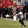 Oklahoma\'s Aaron Colvin (14) is called for interference against Texas Tech\'s Eric Ward (18) during the second half of the college football game between the University of Oklahoma Sooners (OU) and Texas Tech University Red Raiders (TTU) at the Gaylord Family-Memorial Stadium on Saturday, Oct. 22, 2011. in Norman, Okla. Tech won 41-38. Photo by Steve Sisney, The Oklahoman