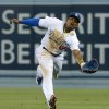 Photo - Los Angeles Dodgers' Yasiel Puig misses the ball as he reaches for a double hit by Arizona Diamondbacks' Martin Prado in the sixth inning of a baseball game Saturday, June 14, 2014, in Los Angeles. (AP Photo/Jayne Kamin-Oncea)