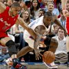 Oklahoma City\'s Serge Ibaka (9) goes for the ball beside Los Angeles Clippers\' Eric Gordon (10) during the NBA basketball game between the Oklahoma City Thunder and the Los Angeles at the Oklahoma City Arena, Wednesday, April 6, 2011. Photo by Bryan Terry, The Oklahoman