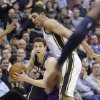 Sacramento Kings\' Jimmer Fredette, front, drives past Utah Jazz\'s Enes Kanter, rear, in the second quarter during an NBA basketball game Monday, Feb. 4, 2013, in Salt Lake City. The Jazz defeated the Kings 98-91 in overtime. Fredette, who played college ball at Brigham Young in Utah, went 0-for-5, including 0-for-3 beyond the arc and finished with 2 points and three turnovers. (AP Photo/Rick Bowmer)