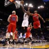 Oklahoma City\'s Kendrick Perkins (5) goes to the basket between Los Angeles Clippers\' Chris Kaman (35), Eric Gordon (10), and Randy Foye (4) during the NBA basketball game between the Oklahoma City Thunder and the Los Angeles at the Oklahoma City Arena, Wednesday, April 6, 2011. Photo by Bryan Terry, The Oklahoman