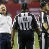 Photo -   Denver Broncos head coach John Fox, left, speaks to officials during the first half of an NFL football game against the Atlanta Falcons, Monday, Sept. 17, 2012, in Atlanta. (AP Photo/John Bazemore)