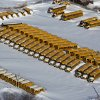 Photo - A row of school busses are buried in snow near Bridgeport, Conn., Sunday, Feb. 10, 2013, in the aftermath of a storm that hit Connecticut and much of the New England states. (AP Photo/Craig Ruttle)