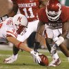 Oklahoma\'s Keenan Clayton (22) goes after a fumble he forced on Nebraska\'s Dreu Young (49) during the first half of the college football game between the University of Oklahoma Sooners (OU) and the University of Nebraska Huskers (NU) at the Gaylord Family-Oklahoma Memorial Stadium, on Saturday, Nov. 1, 2008, in Norman, Okla. BY NATE BILLINGS, THE OKLAHOMAN