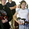 Mia Rigsby, 11, of Midwest City, concentrates on her game as she plays Guitar Hero with Michael White, 16, of Choctaw at the Midwest City Library in Midwest City on Tuesday, March 11, 2008. By John Clanton, The Oklahoman