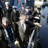 Photo - Family, veterans and current service members take part in a wreath ceremony to mark the 50th anniversary of the sinking of the USS Thresher, Saturday, April 6, 2013, on Memorial Bridge in Portsmouth, N.H. (AP Photo/Michael Dwyer)