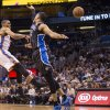 Oklahoma City Thunder\'s Russell Westbrook (0) passes the ball as Orlando Magic\'s Tobias Harris (12) defends on the play during the second half of an NBA basketball game on Friday, March 22, 2013, in Orlando, Fla. The Thunder won 97-89. (AP Photo/Willie J. Allen Jr.) ORG XMIT: FLWA105