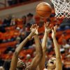 Texas\' Nneka Enemkpali (3) and Oklahoma State\'s Brittney Martin (22) chase a rebound during a women\'s college basketball game between Oklahoma State University (OSU) and the University of Texas at Gallagher-Iba Arena in Stillwater, Okla., Saturday, March 2, 2013. OSU won, 64-58. Photo by Nate Billings, The Oklahoman