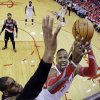 Photo - Portland Trail Blazers' LaMarcus Aldridge blocks a shot by Houston Rockets' Dwight Howard during the first half in Game 1 of an opening-round NBA basketball playoff series, Sunday, April 20, 2014, in Houston. (AP Photo/David J. Phillip)
