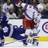 New York Rangers\' Ryan Callahan hits Toronto Maple Leafs\' Nazem Kadri, left, during the second period of an NHL hockey game in Toronto, Saturday, Jan. 4, 2014. (AP Photo/The Canadian Press, Mark Blinch)