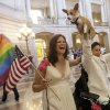 "Photo - Jen Rainin, left, laughs as her wife Frances holds up their dog Punum after they were married at City Hall in San Francisco, Friday, June 28, 2013. A three-judge panel of the 9th U.S. Circuit Court of Appeals issued a brief order Friday afternoon dissolving, ""effective immediately,"" a stay it imposed on gay marriages while the lawsuit challenging the ban advanced through the courts. (AP Photo/Jeff Chiu)"