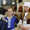 Madison Barron, center, and Abby Boyer talk to Lane Youngblood at the end of the program. Barron was Dolly Madison; Boyer was Lydia Darragh and Youngblood played the role of General George Washington. Wearing authentic era attire, students in Rhonda Watkins\' fourth and fifth grade social studies classes at Schwartz Elementary School portrayed various figures from the American Revolution period during a living history museum program in the school\'s library on Wednesday, Jan. 30, 2013. The students selected a historical person from a list provided by Watkins, and were required to research the subject, write a report and make a verbal presentation about the person. All students in the school were invited to the library to hear the characters tell about their lives. Photo by Jim Beckel, The Oklahoman