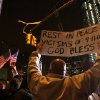 Herman Maisonave, of the Queens borough of New York, right, holds up a sign as he joins those gathered at ground zero in New York as they react to the news of Osama Bin Laden\'s death early Monday morning May 2, 2011. President Barack Obama announced Sunday night, May 1, 2011, that Osama bin Laden was killed in an operation led by the United States. (AP Photo/Tina Fineberg)