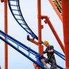 Raymond Niblack installs side bolts as he finishes assembling the RC 48 roller coaster before the opening of the Oklahoma State Fair. Niblack said it usually takes crews about five days to assemble this roller coaster. JIM BECKEL - THE OKLAHOMAN