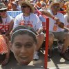 Greg Smith holds a cutout of Tennessee\'s Shelby Virgil (28) during a Women\'s College World Series game between Tennessee and Oregon at ASA Hall of Fame Stadium in Oklahoma City, Saturday, June 2, 2012. Photo by Garett Fisbeck, The Oklahoman