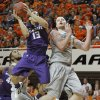 Kansas State\'s Angel Rodriguez (13) is fouled by Oklahoma State\'s Philip Jurick (44) during an NCAA college basketball game between the Oklahoma State University Cowboys (OSU) and the Kansas State University Wildcats (KSU) at Gallagher-Iba Arena in Stillwater, Okla., Saturday, Jan. 21, 2012. Photo by Bryan Terry, The Oklahoman