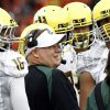 Photo -   Oregon coach Chip Kelly talks with his players during the first half of an NCAA college football game against Oregon State in Corvallis, Ore., Saturday, Nov. 24, 2012.(AP Photo/Don Ryan)