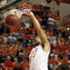 OSU\'s Marshall Moses (33) dunks the ball in front of James Anderson (23) of OSU in the first half during the men\'s college basketball game between the University of Kansas (KU) and Oklahoma State University (OSU) at Gallagher-Iba Arena in Stillwater, Okla., Saturday, Feb. 27, 2010. Photo by Nate Billings, The Oklahoman