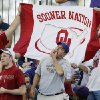 A Washington fan whistles for his team as Oklahoma fans hold a Sooner Nation flag before the college football game between Oklahoma and Washington at Husky Stadium in Seattle, Wash., Saturday, September 13, 2008. BY NATE BILLINGS, THE OKLAHOMAN