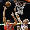 Chicago Bulls\' Joakim Noah (13) goes up for a shot but misses as Phoenix Suns\' Marcin Gortat, of Poland, defends during the first half of an NBA basketball game, Wednesday, Nov. 14, 2012, in Phoenix. (AP Photo/Ross D. Franklin)