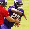 In this photo taken June 18, 2013, Minnesota Vikings running back Adrian Peterson (28) gets the handoff from quarterback Christian Ponder (7) during NFL football minicamp at Winter Park, Tuesday, June 18, 2013, in Eden Prairie, Minn. In training camp, an allergic reaction to shellfish caused Peterson to gasp for air as his throat swelled. Vikings staff had epinephrine injections handy, and the star running back was soon out of trouble. Now, Peterson has added EpiPen to his portfolio of sponsorships, grateful for the safety net it provides. (AP Photo/Genevieve Ross)