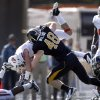 Oklahoma State wide receiver Josh Cooper is upended by Missouri linebacker Andrew Wilson (48) during the first half of an NCAA college football game Saturday, Oct. 22, 2011, in Columbia, Mo. (AP Photo/Jeff Roberson)