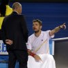 Photo - Stanislas Wawrinka of Switzerland, right, talks with tournament referee Wayne McKewen as Rafael Nadal of Spain takes an injury time out during the men's singles final at the Australian Open tennis championship in Melbourne, Australia, Sunday, Jan. 26, 2014.(AP Photo/Aaron Favila)