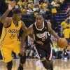 Sacramento Kings\' Marcus Thornton presses the ball into the lane against Indiana Pacers\' Paul George during an NBA basketball game in Indianapolis on Saturday, Nov. 3, 2012. (AP Photo/Doug McSchooler)