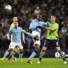 Photo -   Manchester City's Mario Balotelli, centre, and Aston Villa's Ciaran Clark, right battle for the ball during their English League Cup third round match at the Etihad Stadium in Manchester, England, Tuesday Sept. 25, 2012. (AP Photo/Clint Hughes)