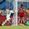 Ghana\'s Andre Ayew (10) watches as his shot goes past United States\' goalkeeper Tim Howard, right, to score his side\'s first goal during the group G World Cup soccer match between Ghana and the United States at the Arena das Dunas in Natal, Brazil, Monday, June 16, 2014. (AP Photo/Julio Cortez)