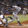 San Diego Padres\' Jesus Guzman follows through on a pinch-hit grand slam home run in front of Tampa Bay Rays catcher Jose Lobaton during the seventh inning of an interleague baseball game Saturday, May 11, 2013, in St. Petersburg, Fla. (AP Photo/Mike Carlson)