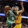 Boston Celtics\' Rajon Rondo (9) drives to the basket against Cleveland Cavaliers\' Tyler Zeller (40) during the first quarter of an NBA basketball game, Tuesday, Jan. 22, 2013, in Cleveland. (AP Photo/Tony Dejak)