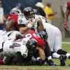 Baltimore Ravens quarterback Joe Flacco (5) push back to get a first down, tackled by Houston Texans defensive end J.J. Watt (99) during the second half of an NFL football game on Sunday, Oct. 21, 2012, Houston, Texas. (AP Photo/Waco Tribune Herald, Jose Yau)