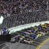 Photo - Austin Dillon, left, and Greg Biffle, right, lead the field at the start of the first of two NASCAR Sprint Cup Series qualifying auto races at Daytona International Speedway in Daytona Beach, Fla., Thursday, Feb. 20, 2014. (AP Photo/David Graham)