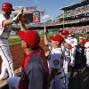 Washington Nationals\' Adam LaRoche, left, celebrates his two-run homer with bench coach Randy Knorr and others, during the fifth inning of a baseball game against the Philadelphia Phillies at Nationals Park Thursday, June 5, 2014, in Washington. (AP Photo/Alex Brandon)