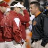 Oklahoma coach Bob Stoops, left, and Oklahoma State coach Mike Gundy talk before the Bedlam college football game between the University of Oklahoma Sooners (OU) and the Oklahoma State University Cowboys (OSU) at Boone Pickens Stadium in Stillwater, Okla., Saturday, Nov. 27, 2010. Photo by Bryan Terry, The Oklahoman ORG XMIT: KOD