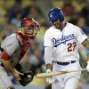 Photo - Los Angeles Dodgers' Matt Kemp, right, reacts after striking out while standing next to Cincinnati Reds catcher Devin Mesoraco during the ninth inning of a baseball game on Wednesday, May 28, 2014, in Los Angeles. The Reds won 3-2. (AP Photo/Jae C. Hong)