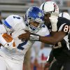 Sapulpa\'s Dae Williams fights off Putnam City\'s Vernon Bills during their high school football game at Putnam City in Oklahoma City, Thursday, Sept. 26, 2013. Photo by Bryan Terry, The Oklahoman
